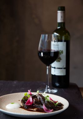 Our Beef Cheeks served with Natural Wine